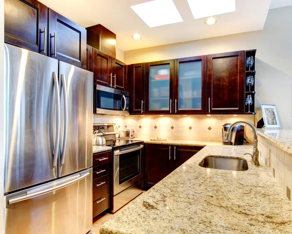 46 gorgeous kitchens with dark cabinets pictures cabinet kitchen Under cabinet lighting and a very reflective and large refrigerator is a very clever design trick