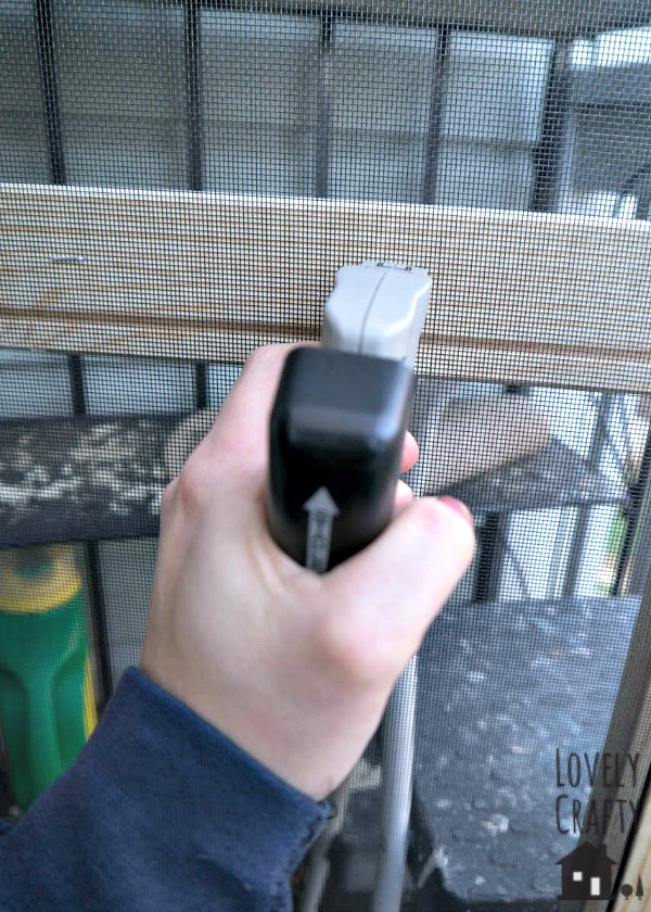 Stapling Magic Mesh To Screen Door