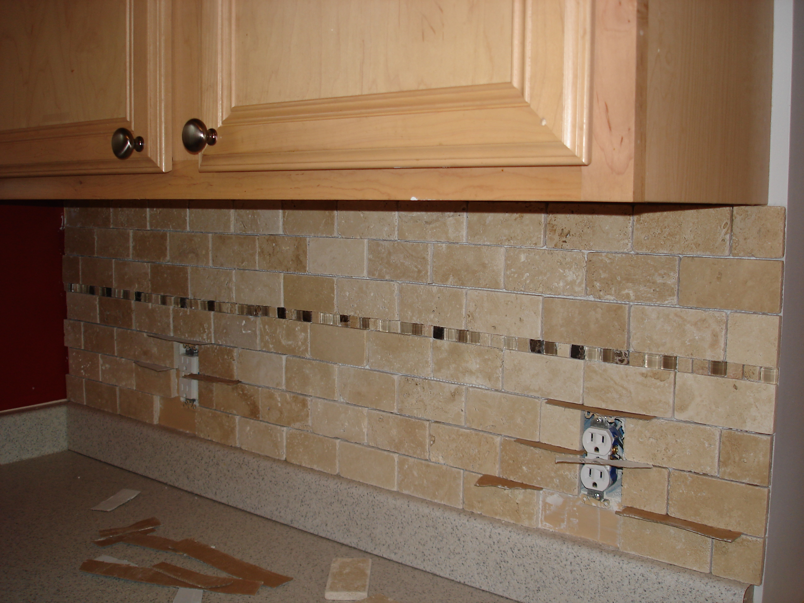 Tutorial tile kitchen back splash after all the tiles have been laid its sealing time unless youre using a pre sealed tile you will need to do this step before grouting dailygadgetfo Gallery