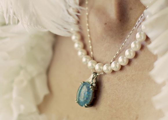 Pearl necklace with bluefire opal stone...