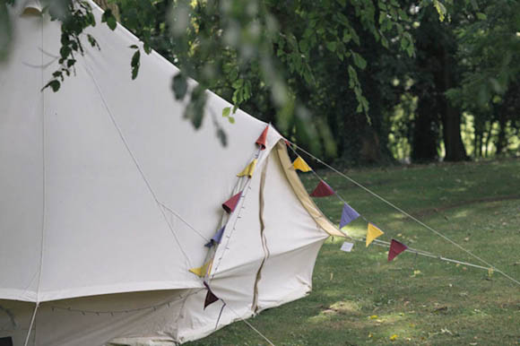 Bell tent village, taxidermy, vintage fair, 1930s style wedding dress