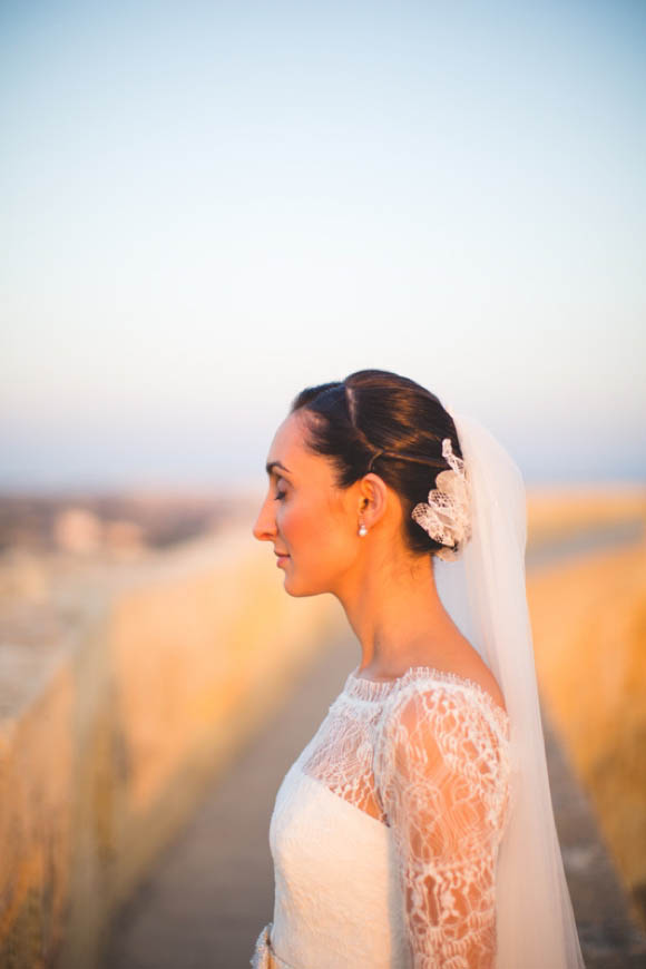 an elegant lace jesus peiro wedding dress for a cathedral
