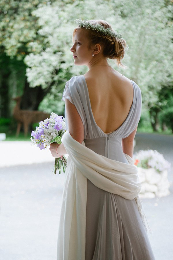 Pale blue Belle and Bunty wedding dress and flowers in her hair