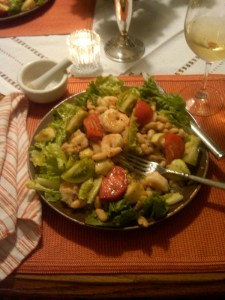 Shrimp salad on an orange placemat.