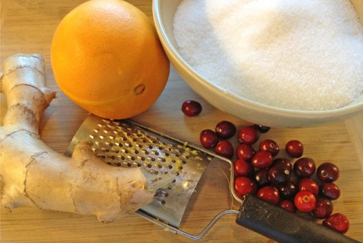Ingredients for a ginger orange cranberry sauce.