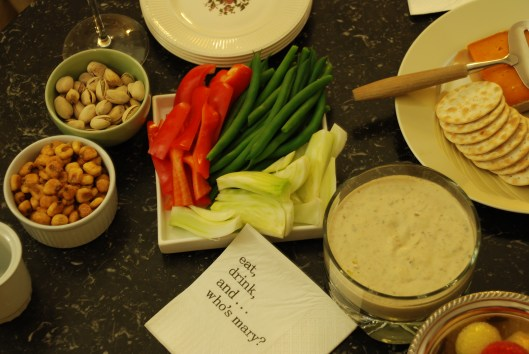 Crackers, nuts, vegetables, and creamy dip.