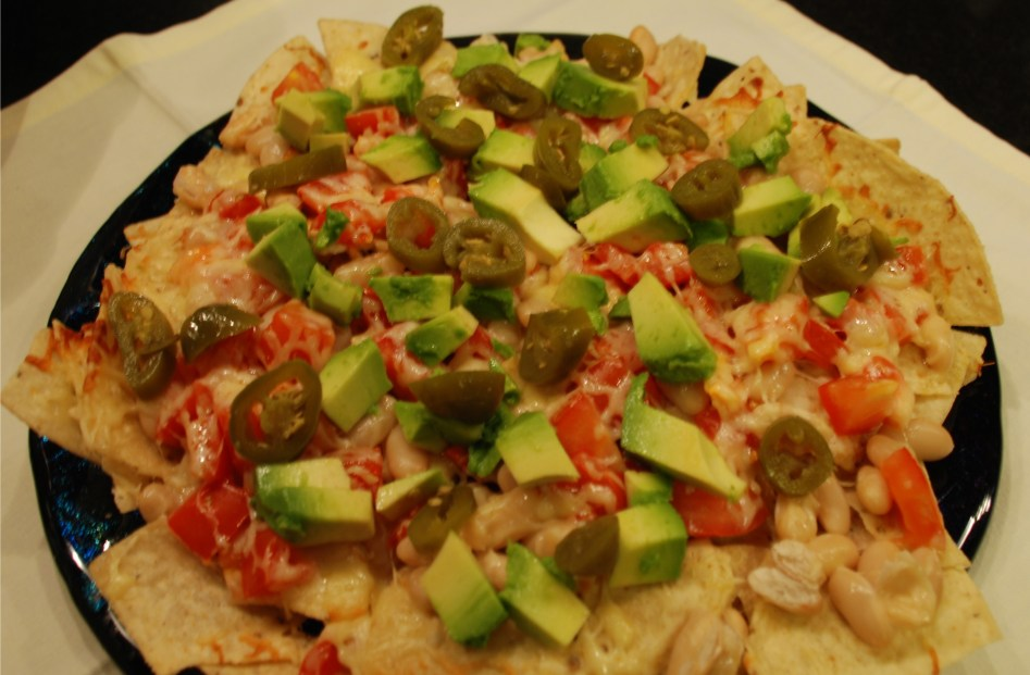 Easy nachos with avocado and jalapenos.