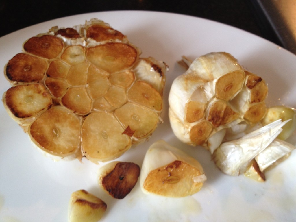 Browned garlic on a white plate.