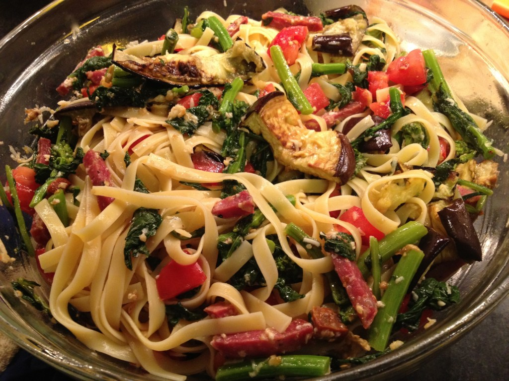 Fettuccine with garlic, eggplant, broccoli rabe, tomatoes, and pecorino Romano cheese.
