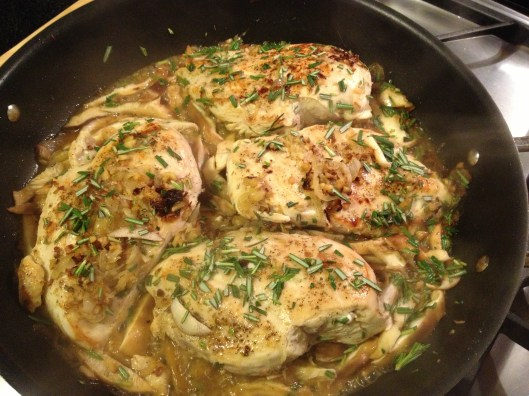 Chicken sauteeing with rosemary.