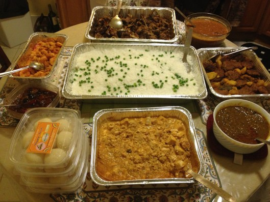 Indian feast - homemade with roasted goat, shrimp, paneer and vegetable patties.
