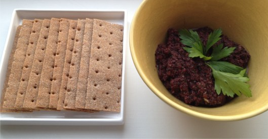Black olive tapenade with whole wheat Finn-crisp crackers.