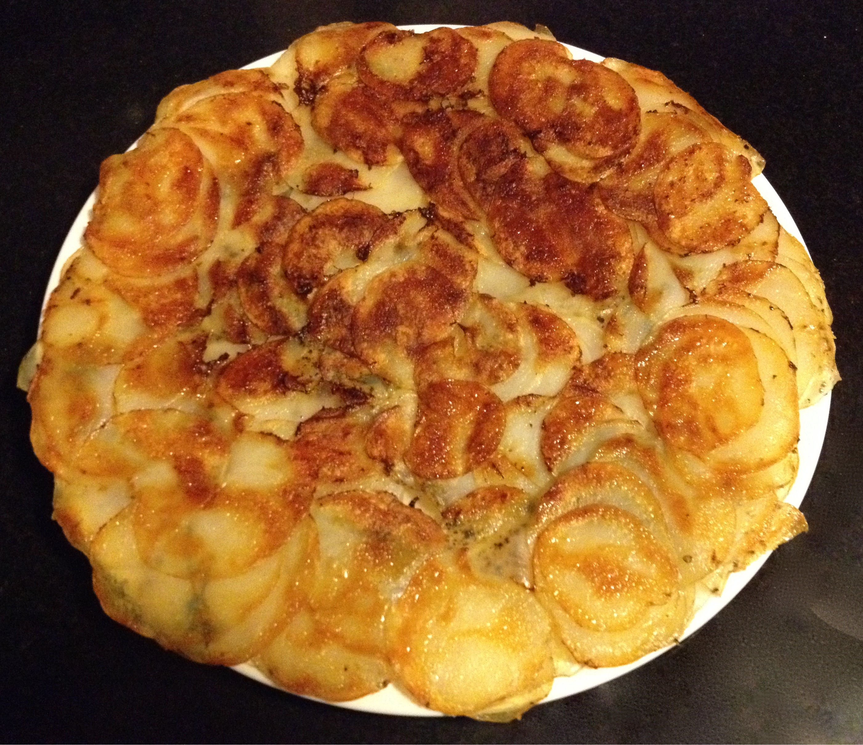 Potato gallette or Potatoes Mary, browned and crispy.