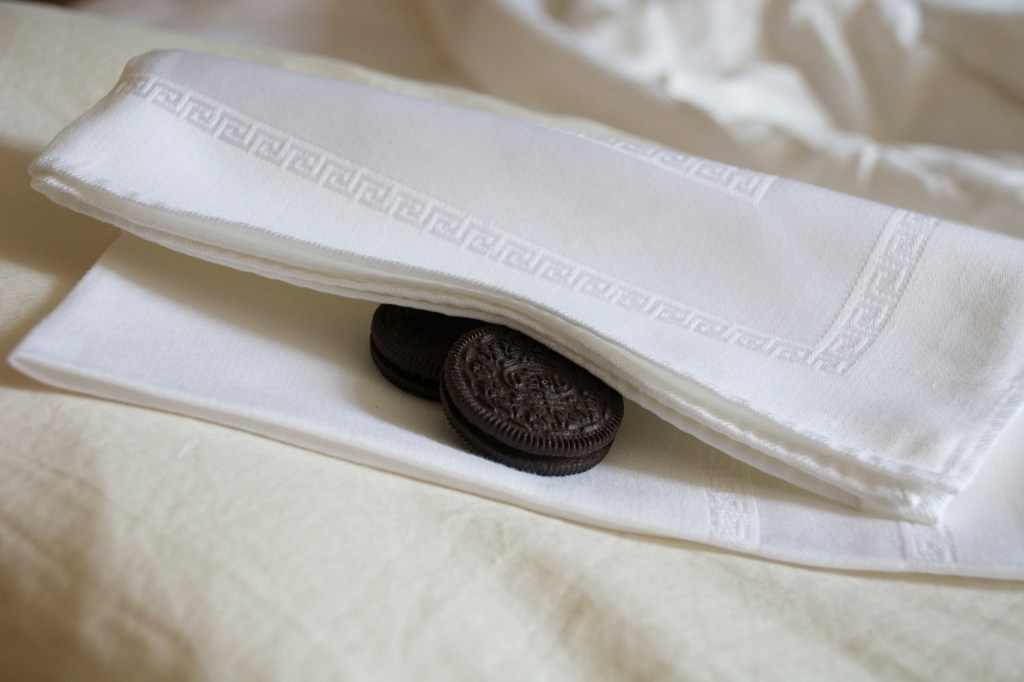 Cookies in a napkin at the foot of the bed.
