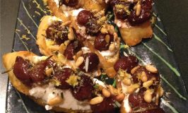 Crostini grape ricotta appetizer.