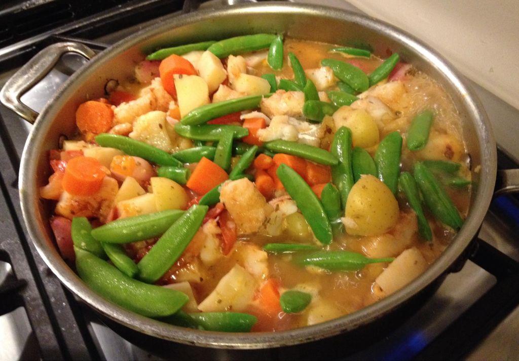 Dutch's Spirits Cod Fish Stew in a skillet.