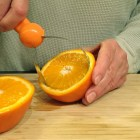 Cit-trease - cutting the orange pulp out.