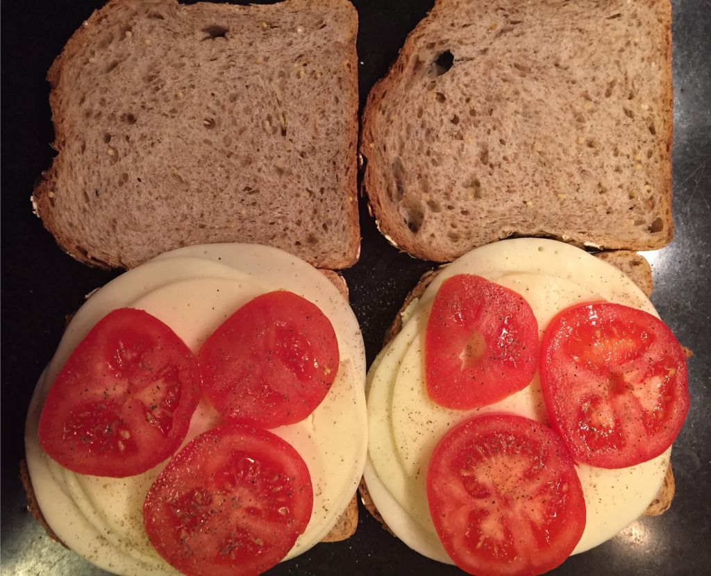 Making grilled Provolone cheese and tomato sandwiches.