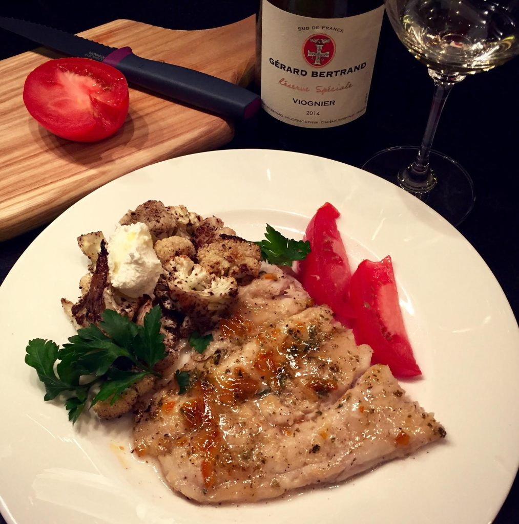 Just Jan's Tangerine Marmalade glazed sea bass on a dinner plate with roasted cauliflower.