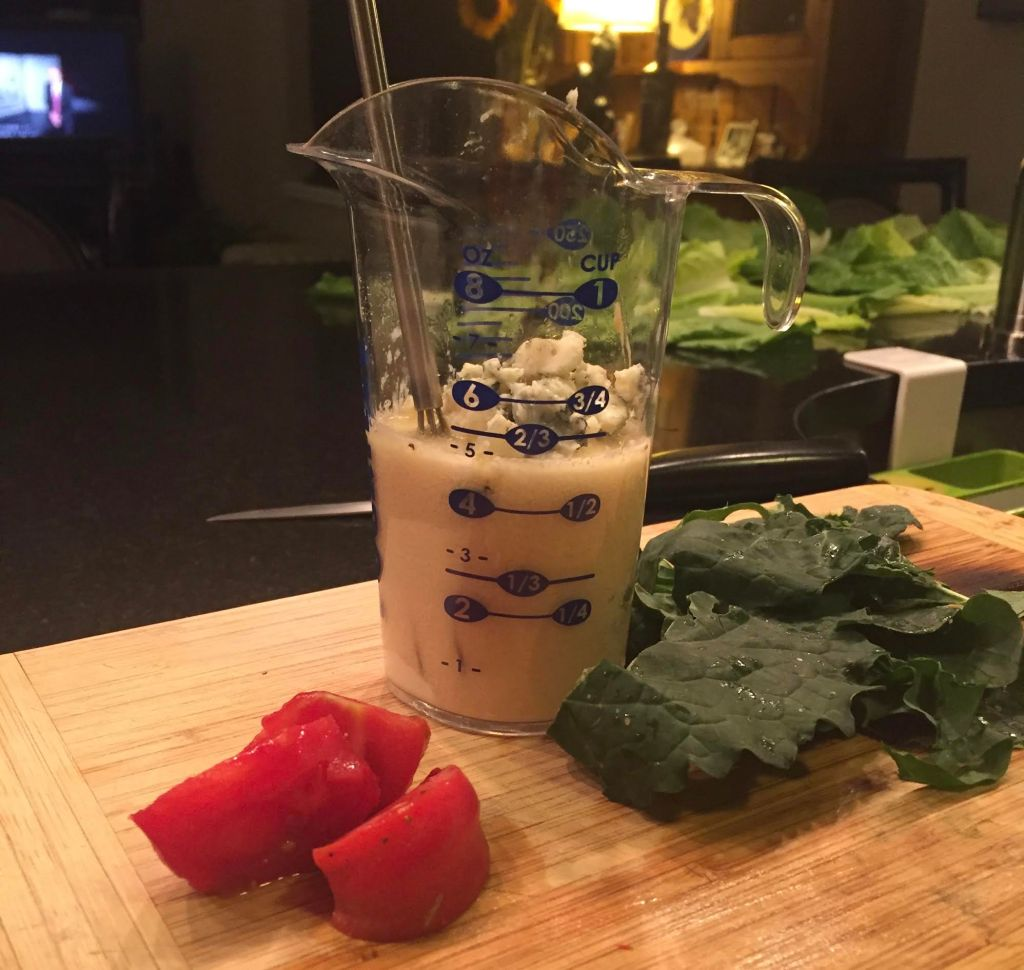 POURfect measuring beaker making Roquefort salad dressing with kale, lettuce and tomatoes.