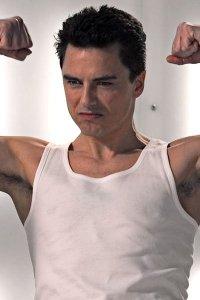 John Barrowman flexing his muscles.