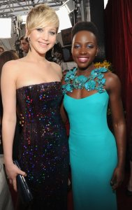 Jennifer Lawrence and Lupita Nyong'o attend the 20th annual Screen Actors' Guild Awards at the Shrine Auditorium on January 18, 2014 in Hollywood, California.