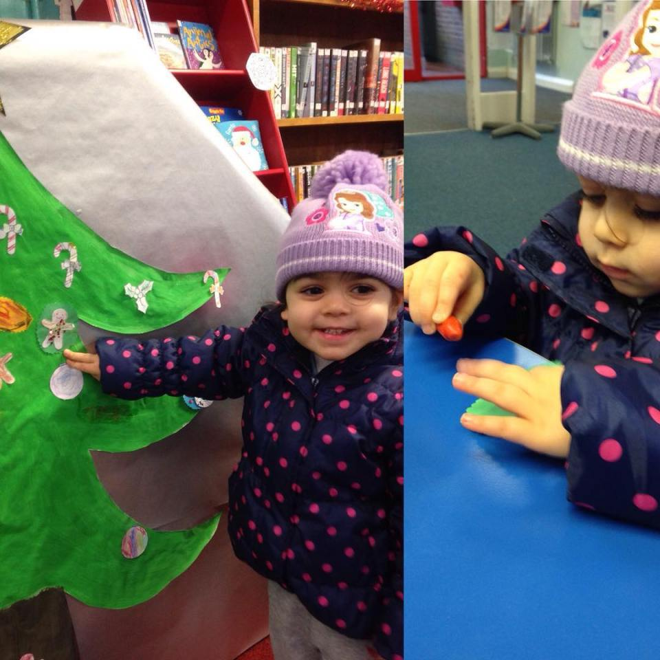 Vani adding her decoration to the tree at Forest Hallhellip