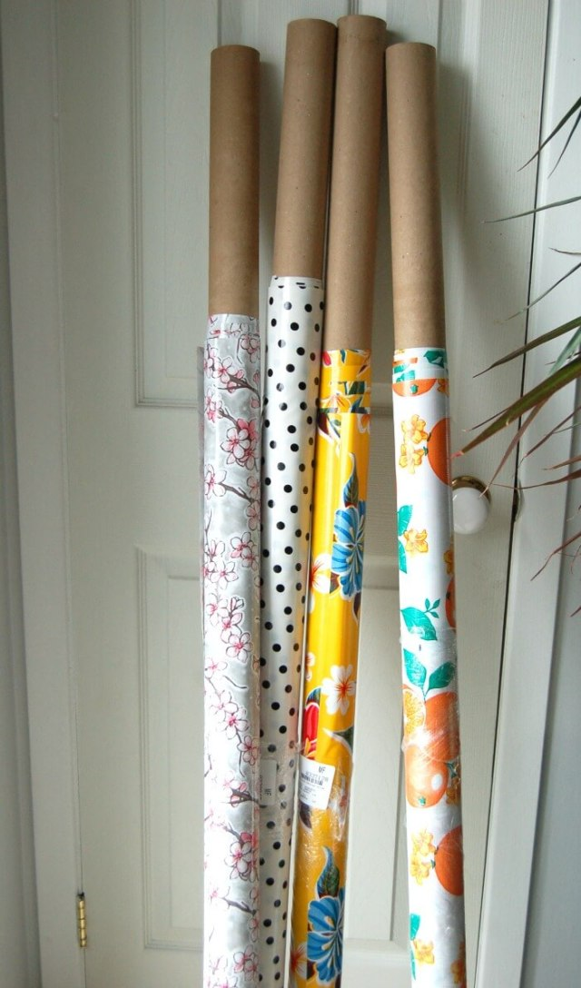Oilcloth rolled up on cardboard tubes