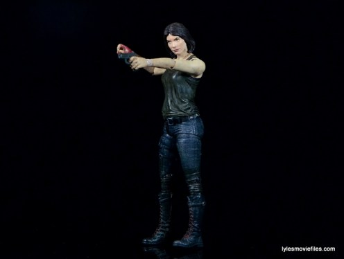 The Walking Dead Maggie Green figure McFarlane Toys -aiming pistol