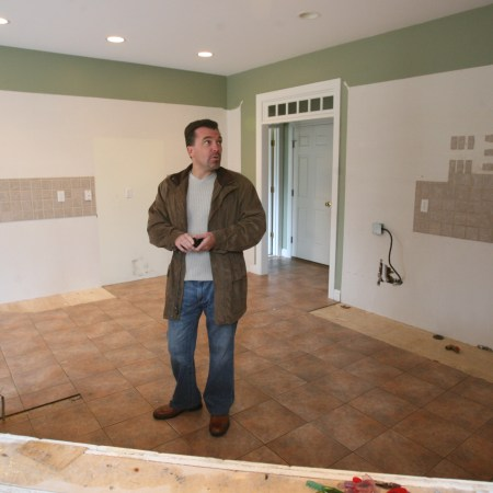 Raymond Horbert, Jr., Gammons Realty, Cranston, is trying to sell this home at 88 Sugarbush Trail, North Kingstown, which has no kitchen left after the homeowners moved out. The cabinets, granite countertops, appliances and downstairs bathroom fixtures were also taken by the homeowner. The Providence Journal/Frieda Squires