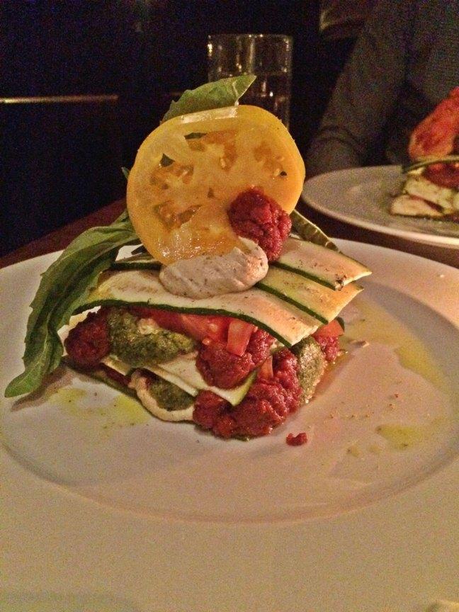 Zucchini and Heirloom Tomato Lasagna with basil pistachio pesto, sun-dried tomato marinara, macadamia pumpkin seed ricotta.