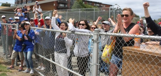 Pacific Little League fans cheer for their team after winning the state title.