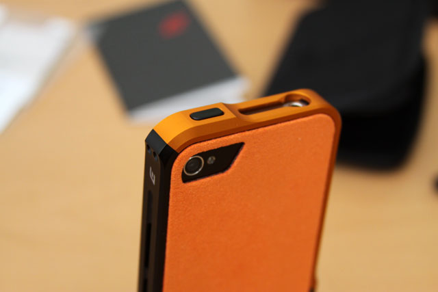 This picture doesn't quite do justice to how NONmatching the Ultrasuede is to the orange case.