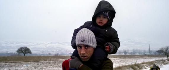 PRESEVO, SERBIA - JANUARY 26:  Migrants walk in sub zero temperatures near the Macedonian-Serbian border on January 26, 2016 in Presevo, Serbia.  Migrants have been braving sub zero temperatures as they cross the border from Macedonia into Serbia. (Photo by Milos Bicanski/Getty Images)