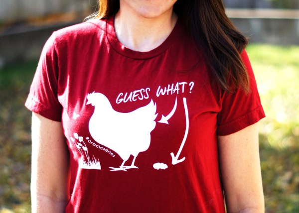 Elizabeth models 'Chicken Butt' T-shirt in cranberry with white printing
