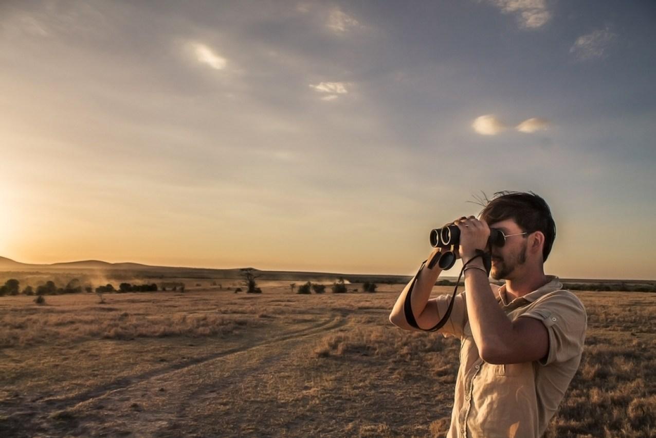 Surveying the open plains through binoculars © Ol Pejeta Safari Cottages