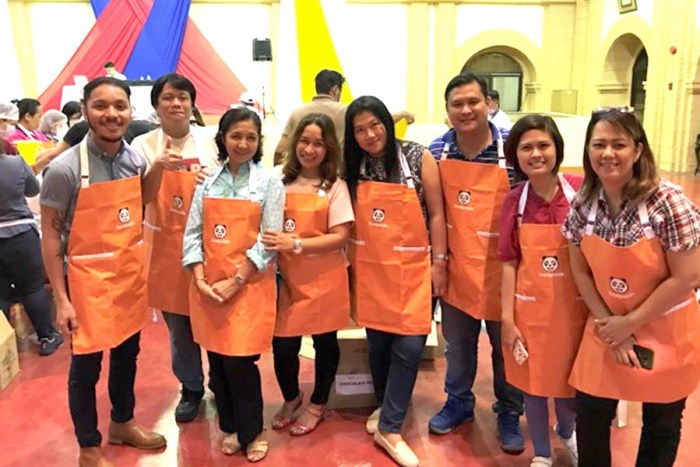 Volunteers posing and pausing for a break during the Rise Against Hunger Meal Packaging Activity at the Department of Health Manila Convention Hall