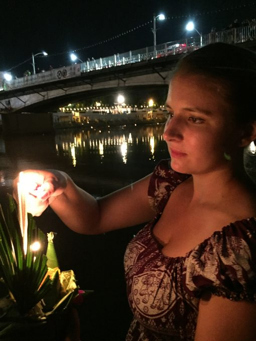 Light a floating Krathong for the Buddhist celebration of Loy Krathon in Chiang Mai, Thailand