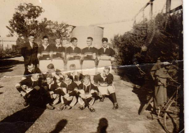 De La Salle Old Boys 1937. The following names are written onthe back: Herb (Schofield I assume), Bede, Ken, Austin, George, Charlie, Roy Bell, Des, Roy Quinn, Claude, Jack, Ron, Jack Blanigan?