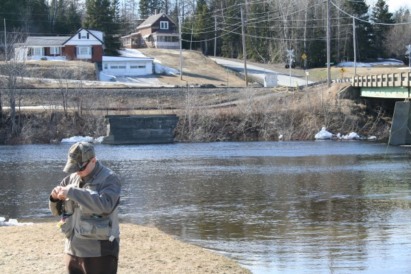 Thomas Morin changing flies (That he tied) before wandering back into the icy waters!