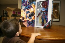 The Boy is very eager to see what is in the box.