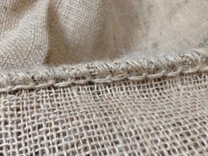 Stitching on burlap coffee sack