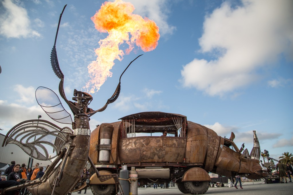The Maker Faire safari tour: giant metal rhino with fire-breathing insect.