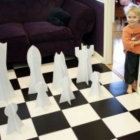 Slot together giant chess set with small human for scale