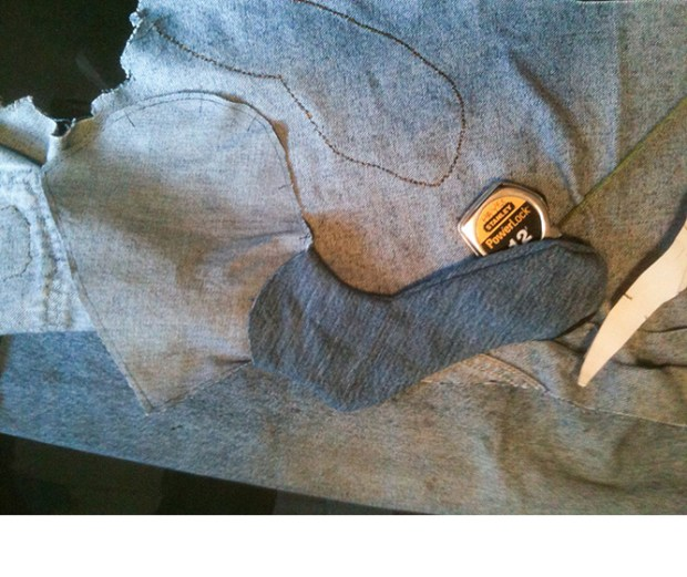 The near hindleg before attaching, atop the body denim where the foreleg has already been sewn to the outside.