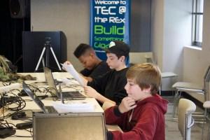 The team working through their first Arduino sketch, blinking an LED light.