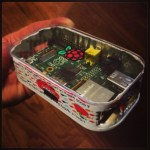 My Raspberry Pi is packed like sardines...literally! I cut open a sardine can from the bottom (leaving the peel-away tab on the top intact) & crammed my Raspberry Pi in. There is absolutely NO wiggle room! It works brilliantly too! I cut holes in the sides to accommodate the exposed ports & covered the top with a hand-cut/hand-sanded acrylic lid complete with hand-painted Raspberry Pi logo! It's the first of it's kind I've seen anywhere. Now, if only I could get rid of that sardine smell…