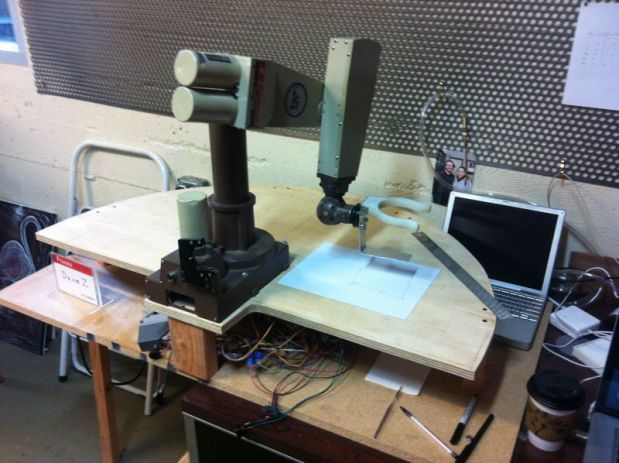 The arm with the 3D-printed gripper in place