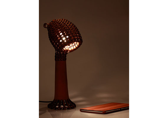 Tjiang Supertini's leather lamp combines Indonesian basket craft with laser cutting, resulting in a look that wouldn't be out of place in a Hobbit house.