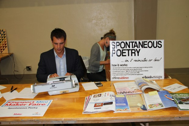 David Schools, typing away on his typewriter at his Spontaneous Poetry booth.